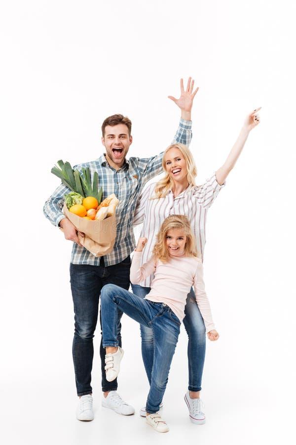 Полнометражный портрет excited семьи стоковая фотография