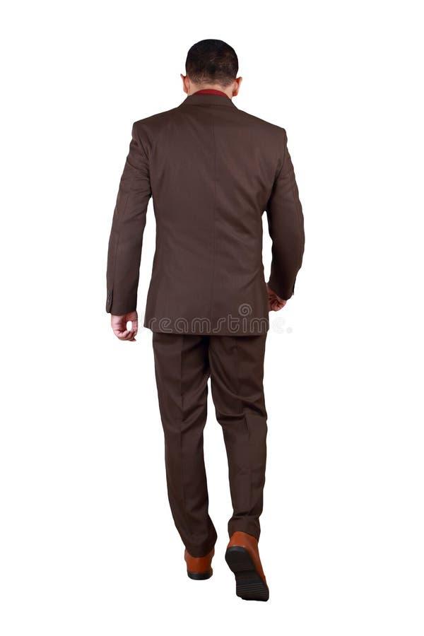 Полный портрет азиатского бизнесмена идя, вид сзади тела стоковые изображения