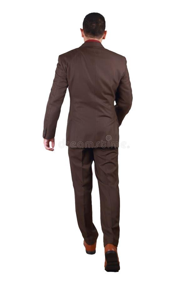 Полный портрет азиатского бизнесмена идя, вид сзади тела стоковые фото