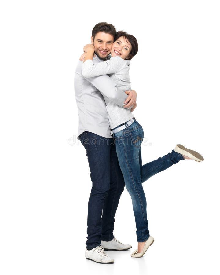 Полный портрет счастливых пар изолированных на белизне стоковое изображение rf