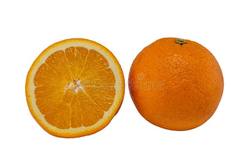 Половина и полный апельсин стоковое фото
