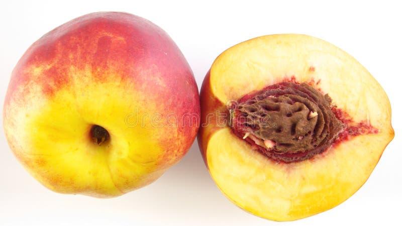 Половинный персик & персик стоковое фото rf