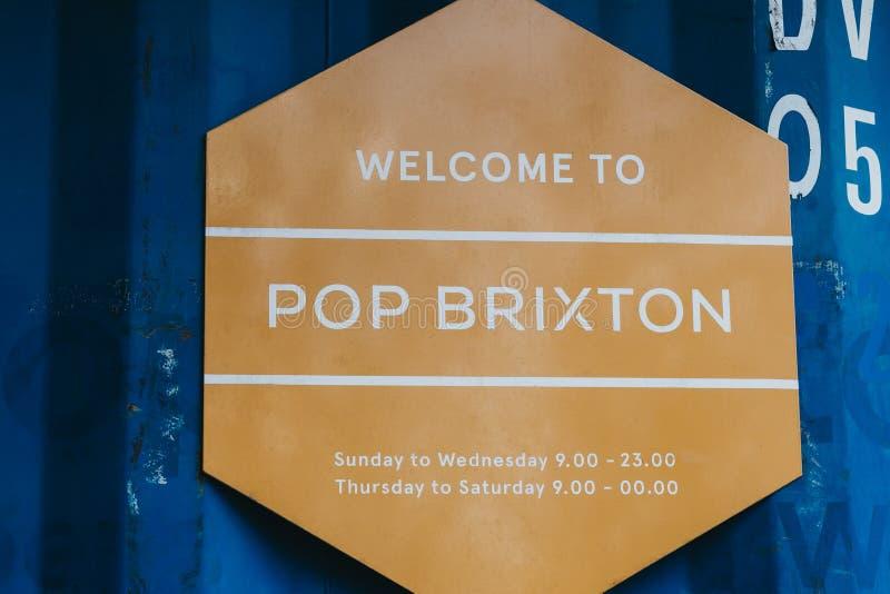 Положительный знак на попе Brixton, Лондоне, Великобритании стоковое фото