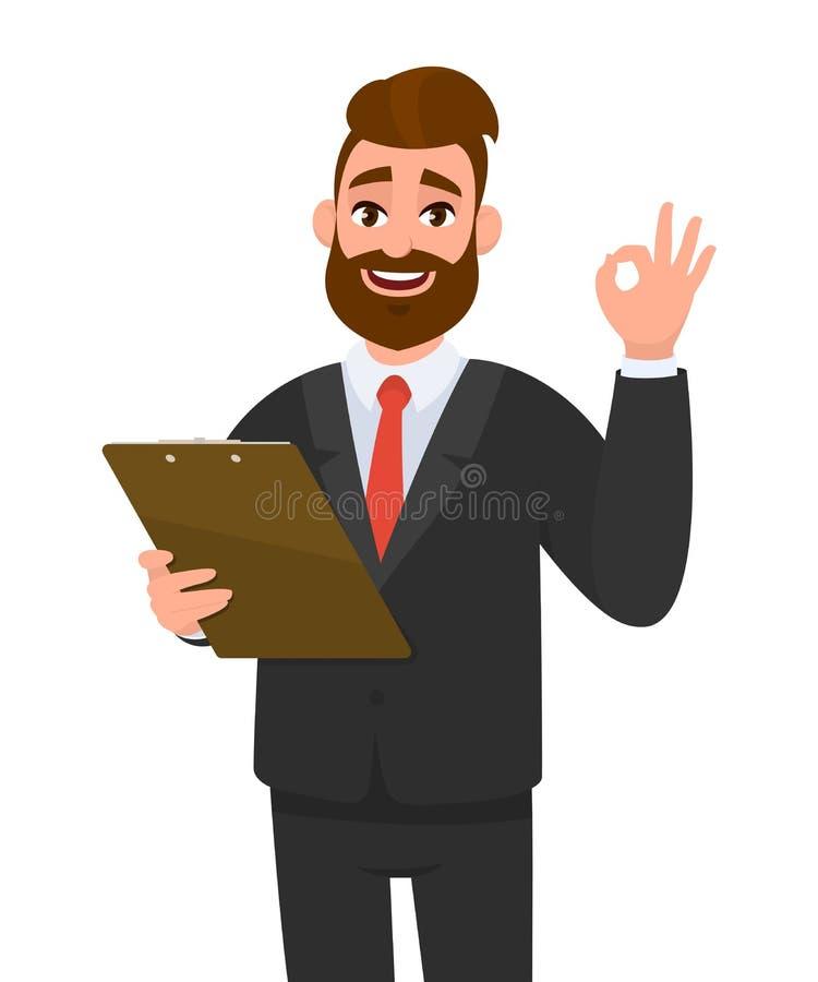 Положительный молодой бизнесмен нося доску сзажимом для бумаги и показ удерживания костюма или делая ок, жест ОК или спеть с паль иллюстрация штока