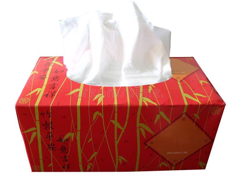 положите бумажную красную ткань в коробку стоковое изображение