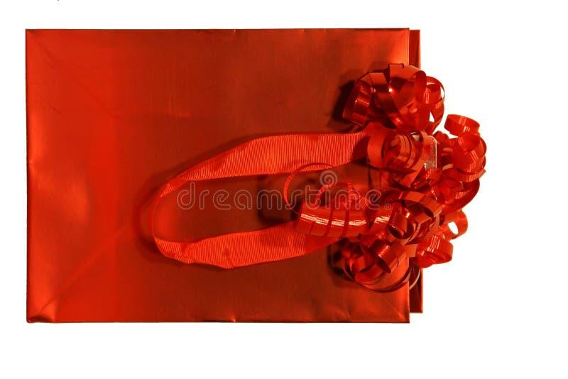 положите красный цвет в мешки подарка стоковые фото