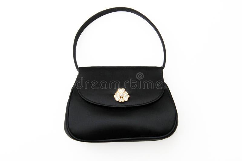 положите черное портмоне в мешки вычуры вечера стоковые фото
