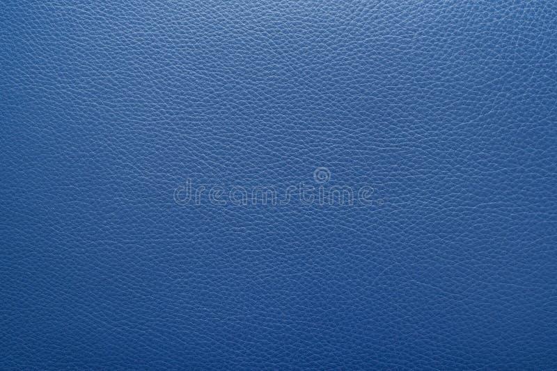 Полуночные голубые кожаные предпосылка или текстура стоковое фото rf