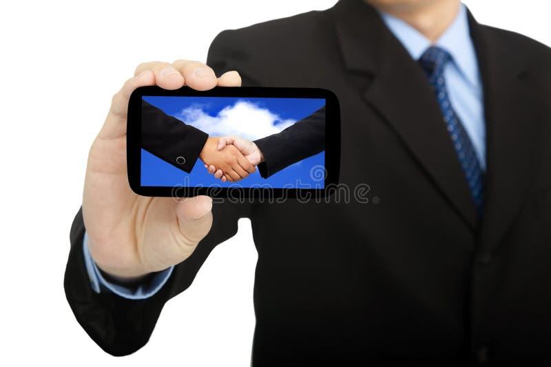 польза smartphone бизнесмена стоковое изображение rf