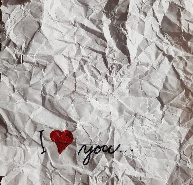 Полюбите вас бумажный красный цвет сердца рассказа стоковое фото rf