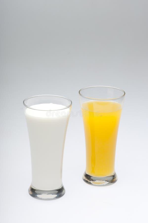 помеец молока сока стекел стоковые изображения rf