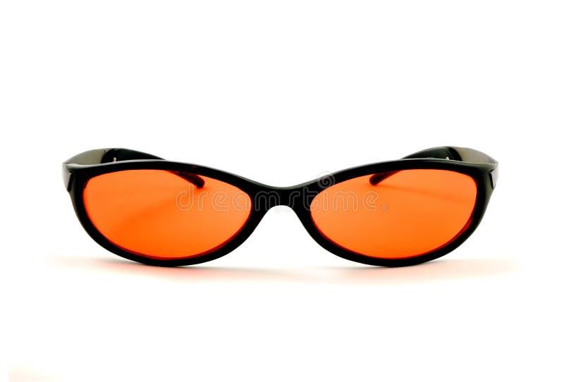 померанцовые солнечные очки стоковые фото