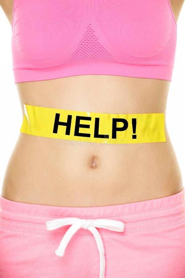 Помощь живота - женщина с проблемами веса тела стоковые изображения