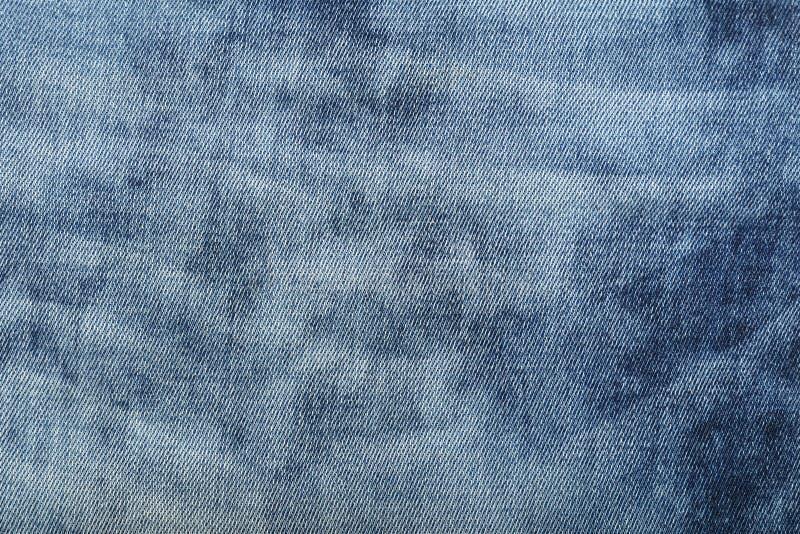 Помытая синью предпосылка текстуры джинсовой ткани джинсов стоковое изображение