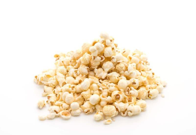 попкорн карамельки на белизне стоковые изображения