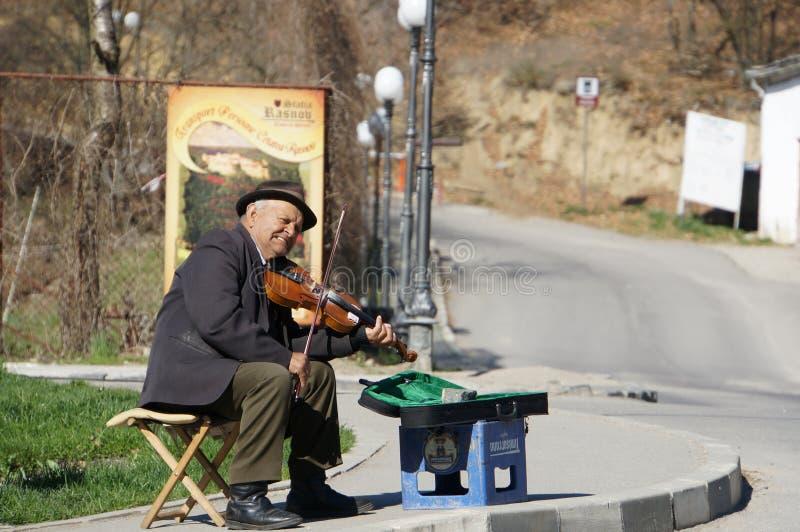 Попрошайка на улице стоковое изображение
