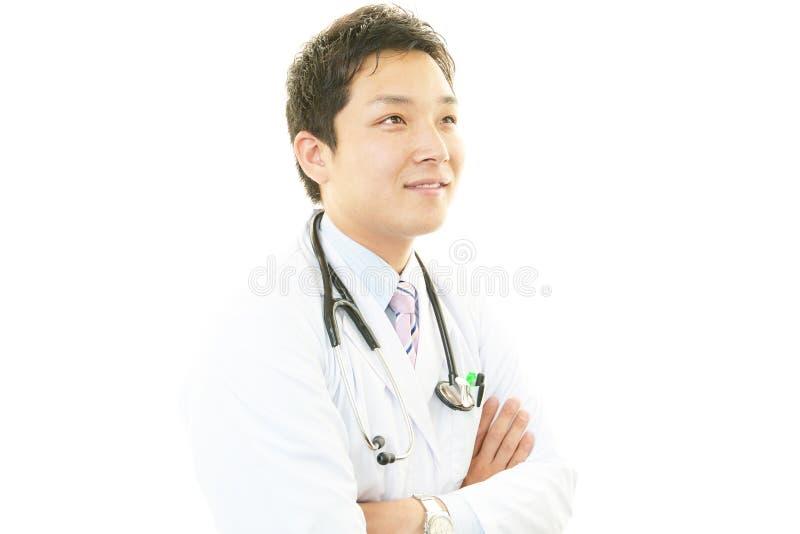 Портрет азиатского врача стоковое изображение rf