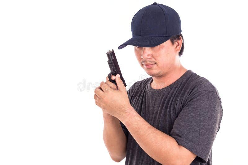 Портрет азиатского человека держа оружие изолированный на белизне стоковые фотографии rf