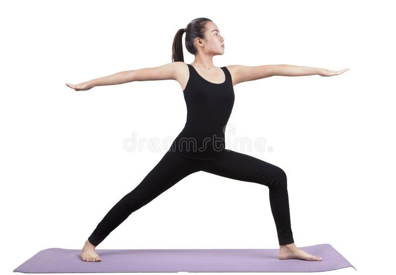 Портрет азиатской женщины нося костюм черного тела сидя в йоге стоковое фото rf