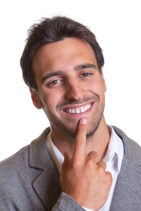 Портрет латинского бизнесмена в сером костюме стоковые изображения rf