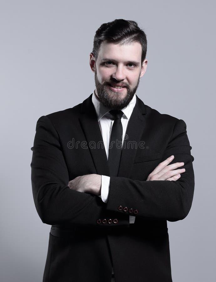 портрет бизнесмена успешный Изолировано на серой предпосылке стоковое изображение rf