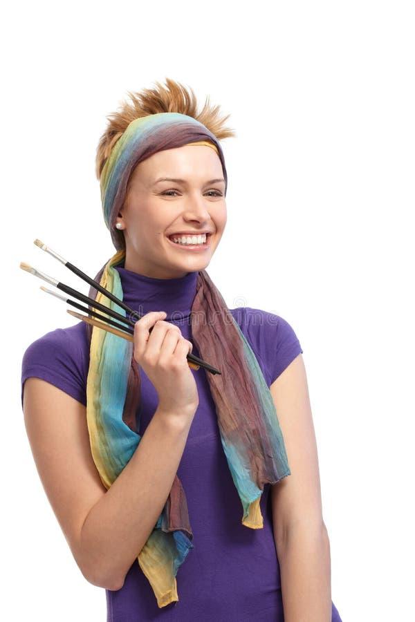 Портрет женский усмехаться художника стоковое изображение