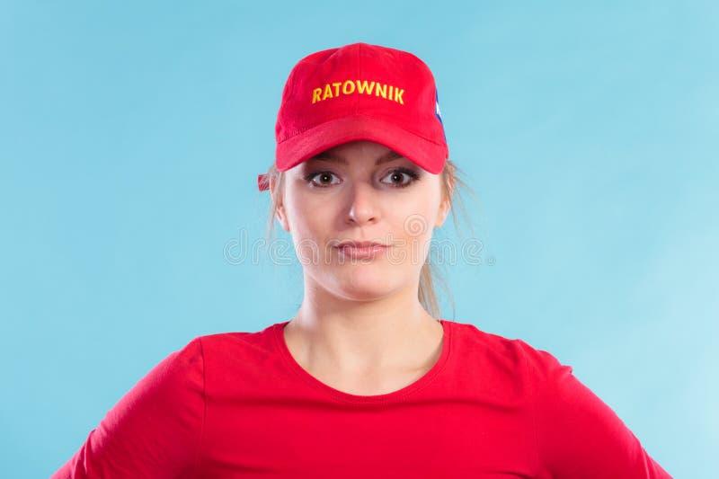 Портрет женщины личной охраны в красной крышке стоковые изображения