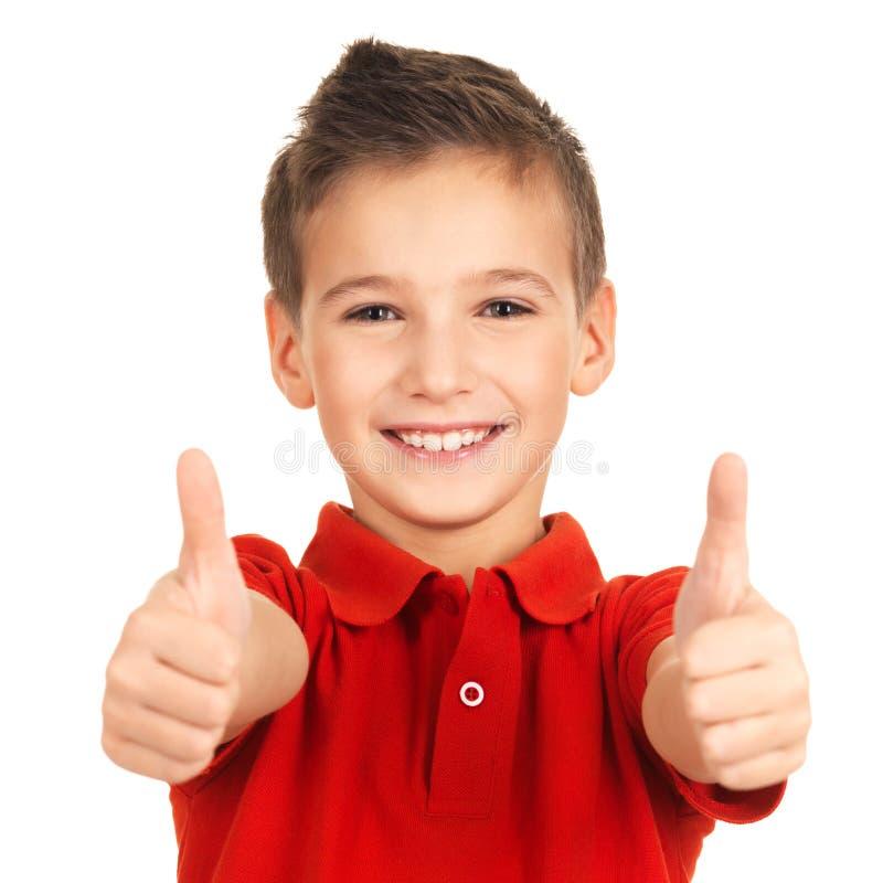 Портрет жизнерадостного мальчика показывая большие пальцы руки поднимает жест стоковые изображения rf