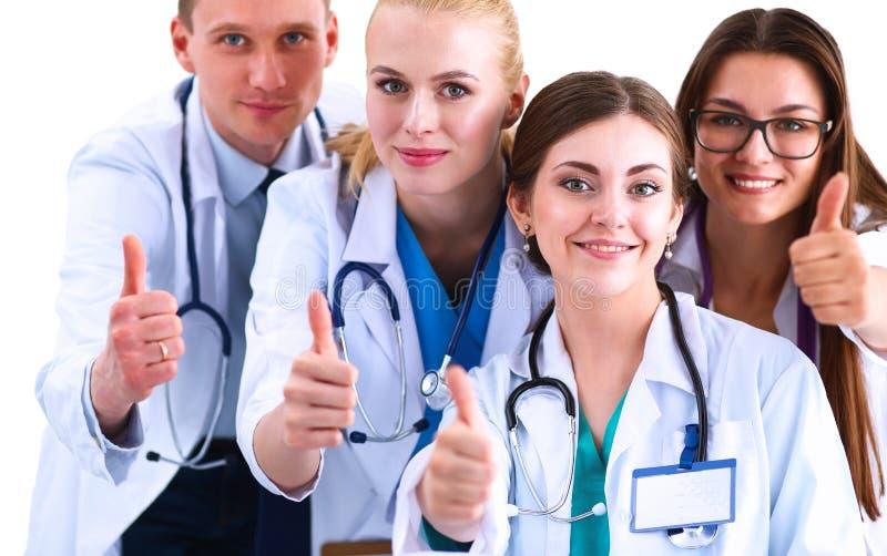 Портрет команды докторов показывая большие пальцы руки вверх стоковое фото rf