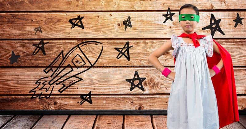 Портрет костюма супергероя девушки нося стоя с руками на бедрах стоковое изображение rf