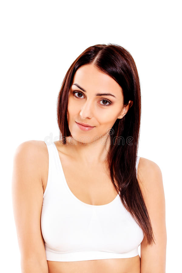 Портрет красивой девушки пригонки в бюстгальтере Изолировано на белизне стоковые фото