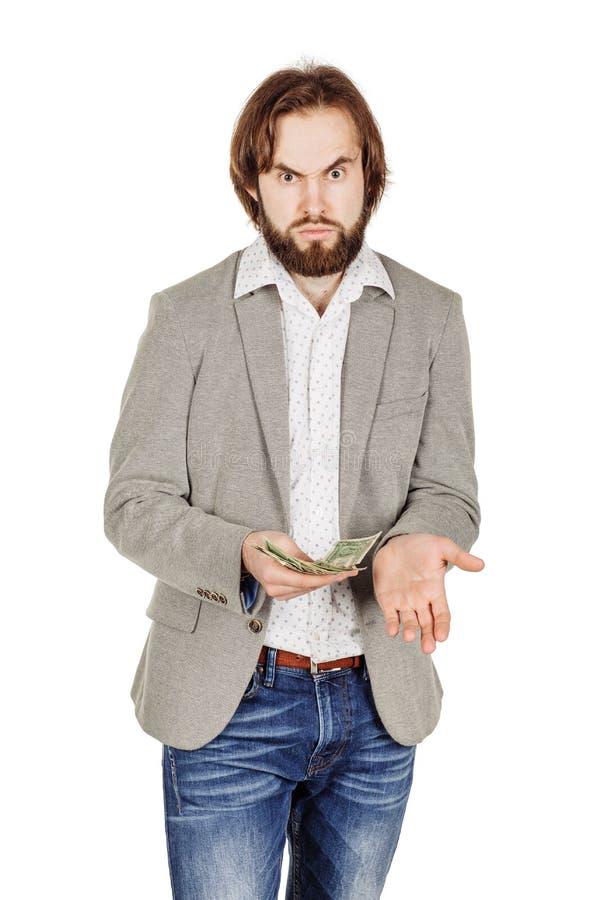 Портрет крупного плана молодых удерживания бизнесмена и денег d отсчетов стоковые изображения