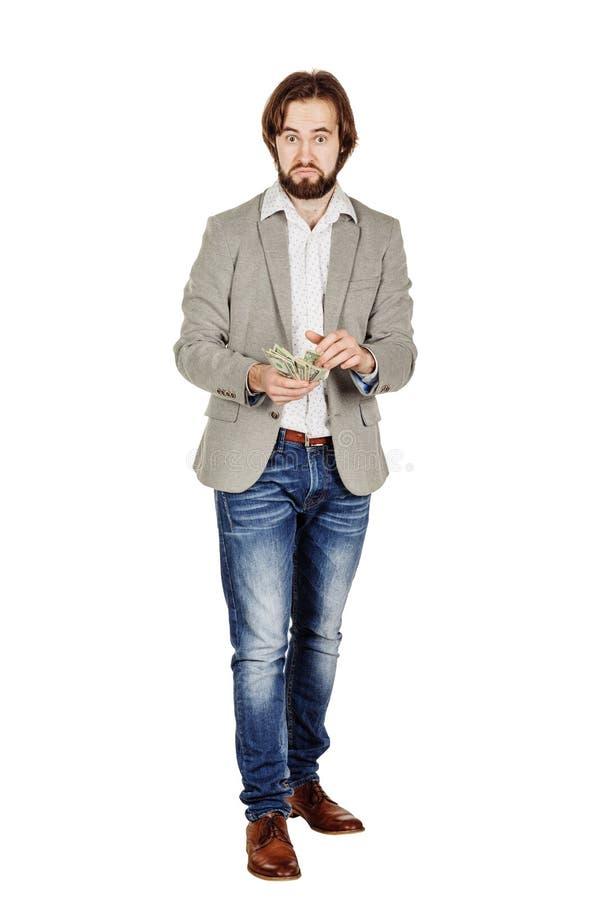 Портрет крупного плана молодых удерживания бизнесмена и денег d отсчетов стоковое изображение
