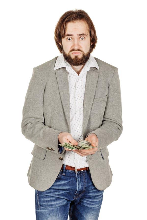 Портрет крупного плана молодых удерживания бизнесмена и денег d отсчетов стоковое фото rf