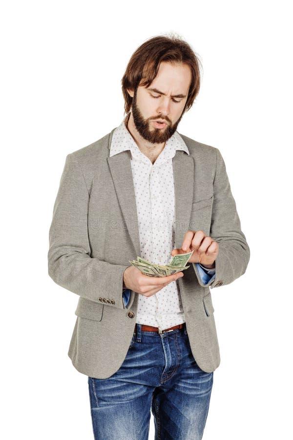 Портрет крупного плана молодых удерживания бизнесмена и денег d отсчетов стоковые фотографии rf