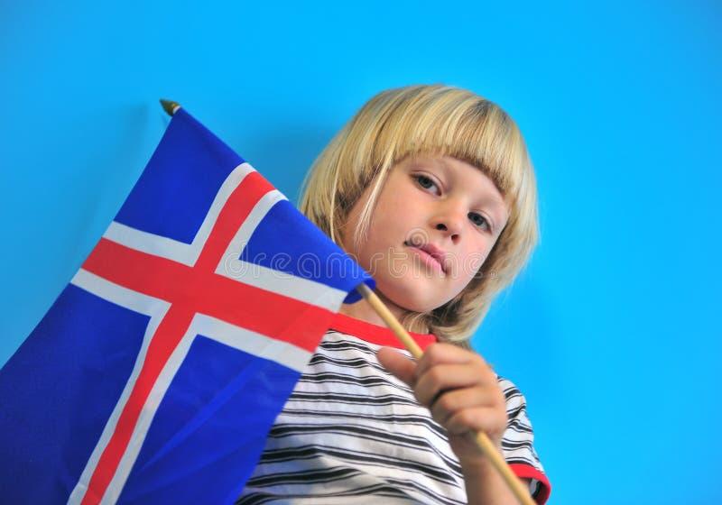 Портрет мальчика с флагом Исландии стоковые фотографии rf