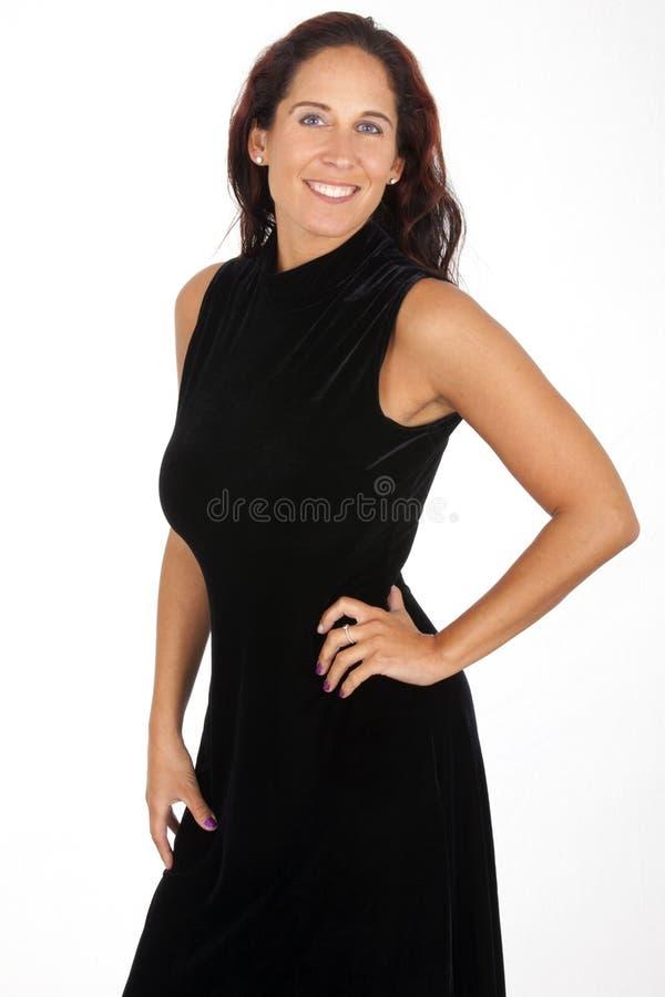 Портрет: Милая женщина в длинном черном платье стоковое фото rf