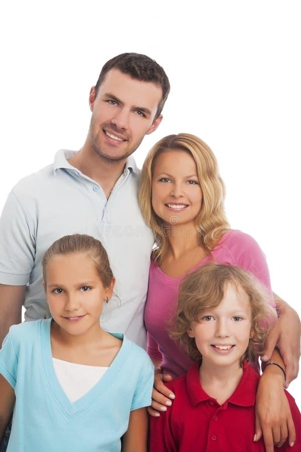 Портрет молодых людей семьи из четырех человек стоя совместно стоковое изображение
