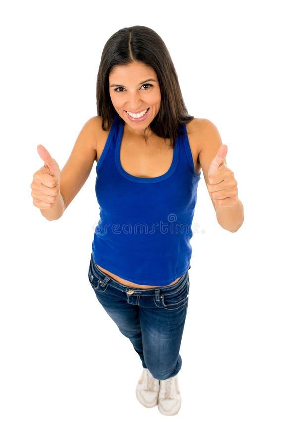 Портрет молодой красивой латинской женщины давая большой палец руки вверх по счастливому и excited стоковые изображения rf