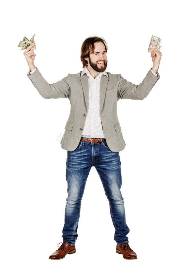 Портрет молодых удерживания бизнесмена и bi доллара денег отсчетов стоковые фото