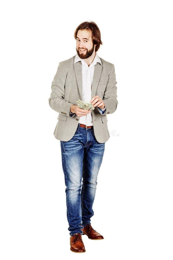 Портрет молодых удерживания бизнесмена и bi доллара денег отсчетов стоковые фотографии rf