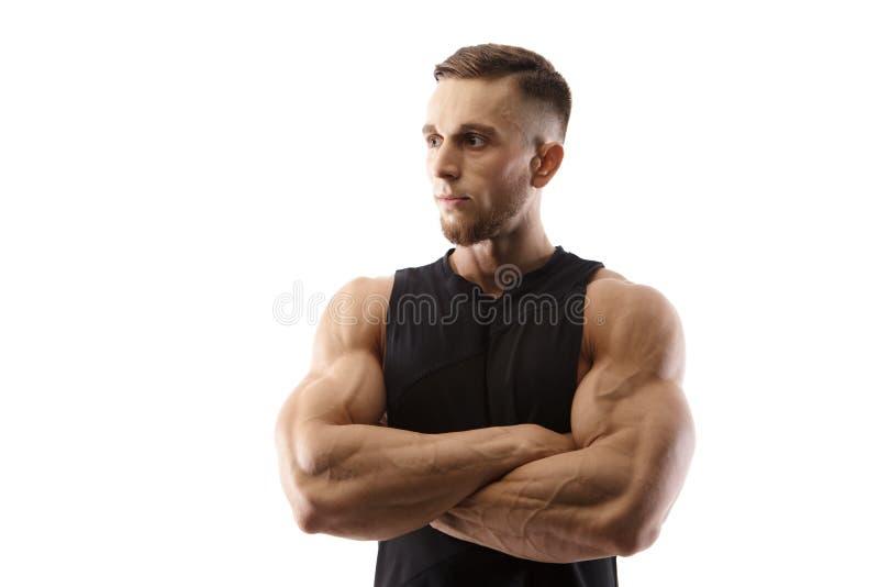 Портрет мышечной мужской модели изолированной на белой предпосылке стоковые фото