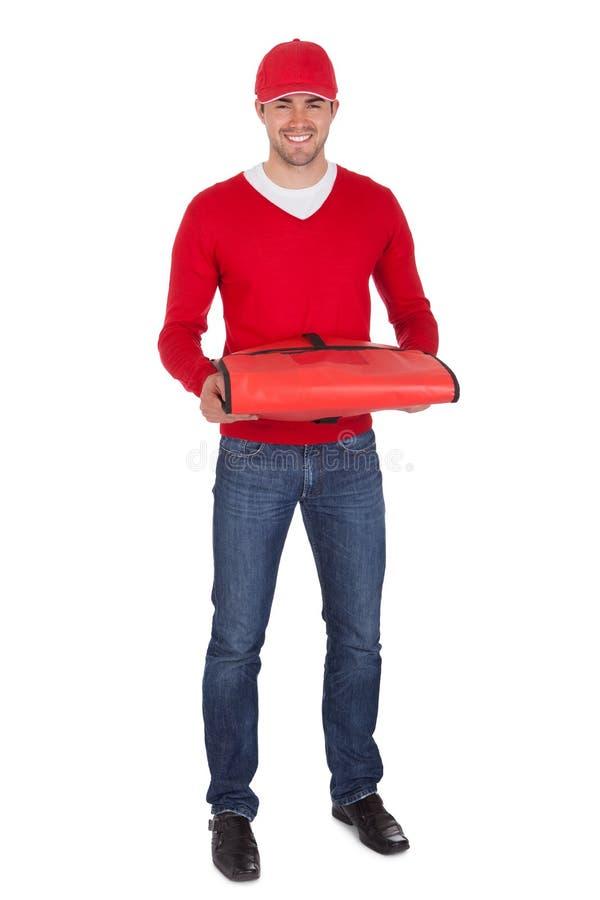 Портрет носильщика мелких грузов пиццы с термальным мешком стоковая фотография rf