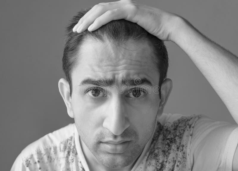 Портрет потревоженного человека стоковая фотография rf