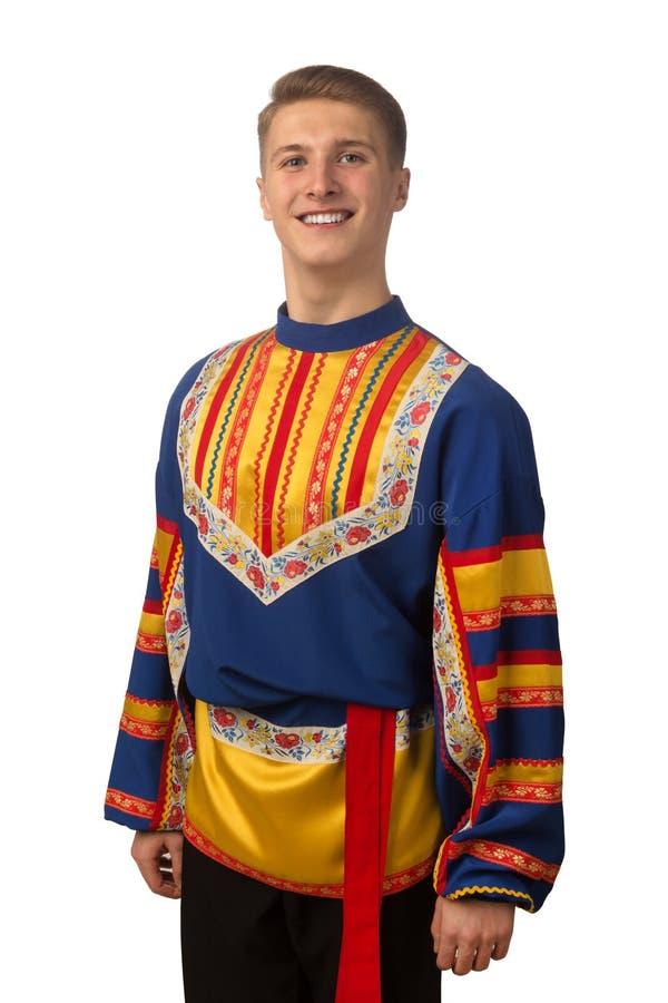 Портрет привлекательного русского парня в фольклорном костюме изолированном на белизне стоковая фотография