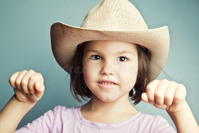 Портрет ребенка в ковбойской шляпе стоковая фотография rf