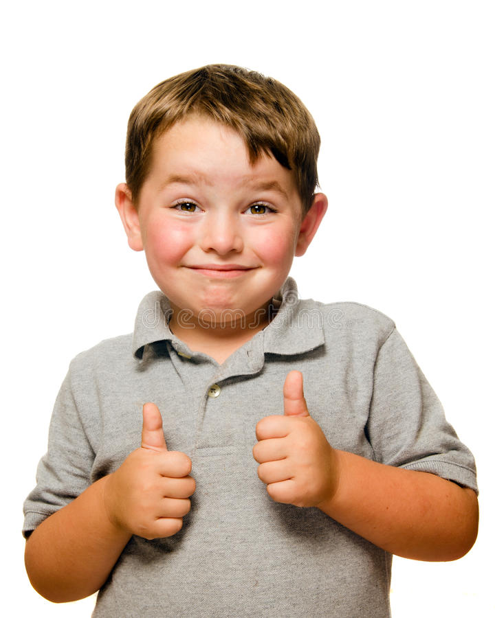 портрет ребенка уверенно показывая большие пальцы руки вверх стоковое изображение rf