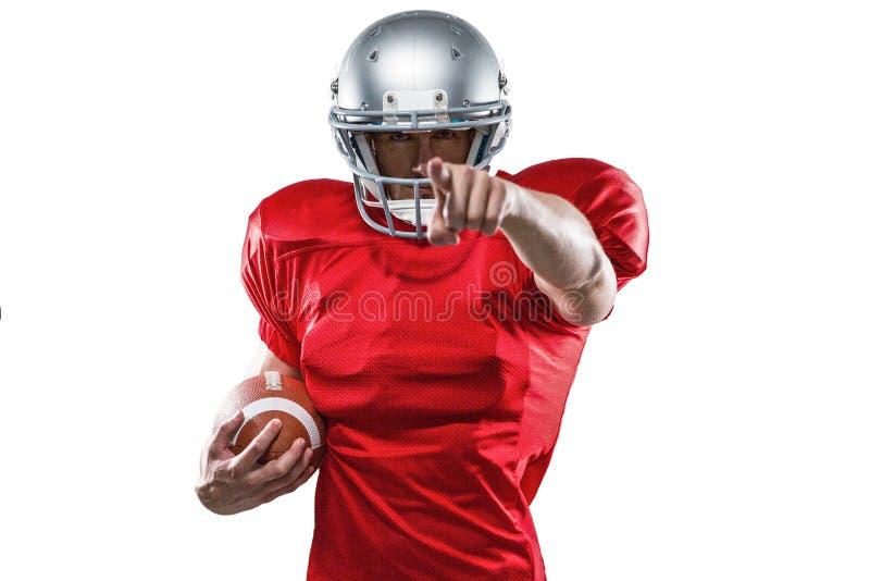 Портрет резвится игрок в красный указывать jersey стоковая фотография