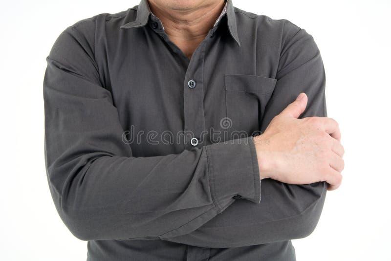 Портрет руки бизнесмена перекрестной для того чтобы показать доверие изолированный на белой предпосылке стоковое фото rf
