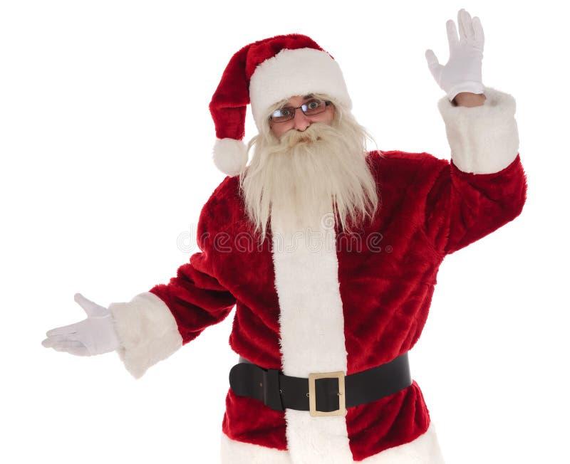 Портрет Санта Клауса представляя для того чтобы встать на сторону с рукой вверх стоковое фото rf